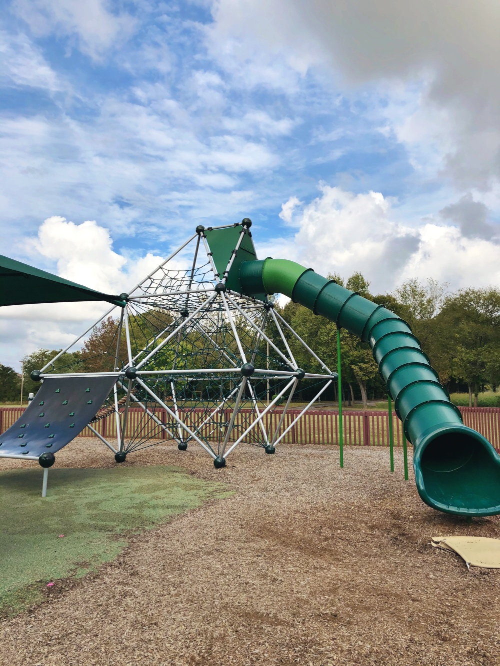 large green rope climbing structure and tall green slide at Don Fox Community Park in Lebanon, TN
