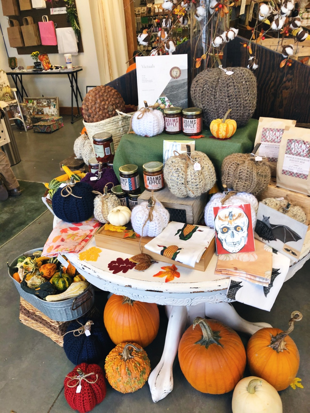 lifestyle grocery store tablescape of real and knitted pumpkins at Demeter's Common in Lebanon, TN