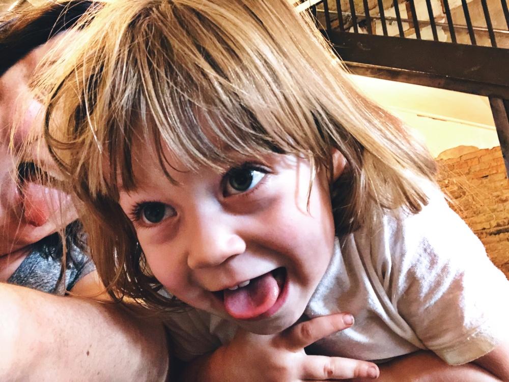 toddler sticking tongue out at selfie camera