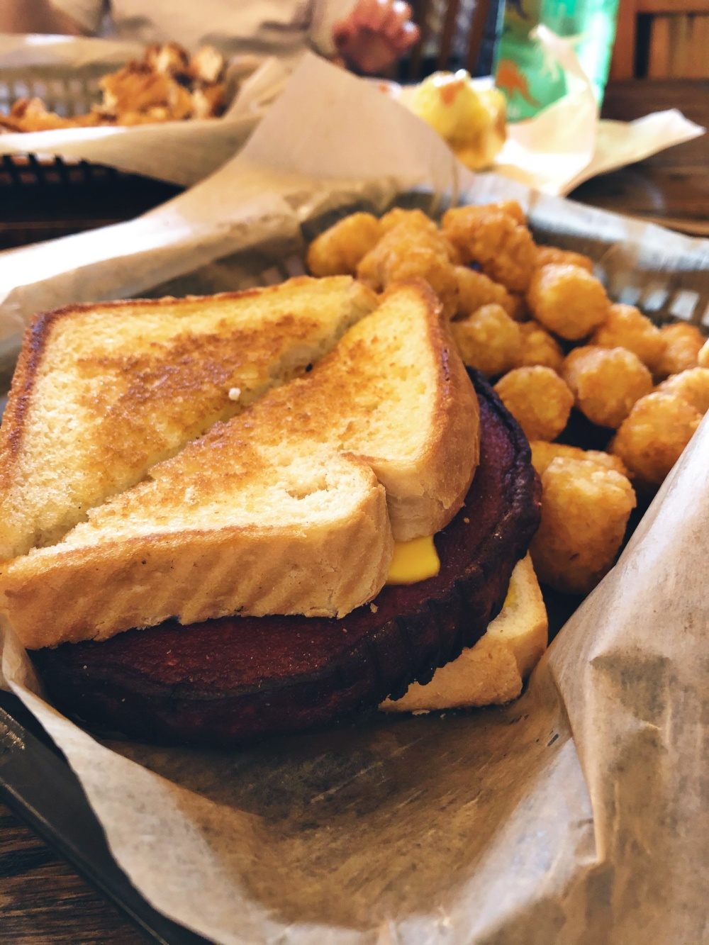 thick slab of fried bologna sandwiched between two slices of American cheese and white bread at Town Square Social in Lebanon, TN